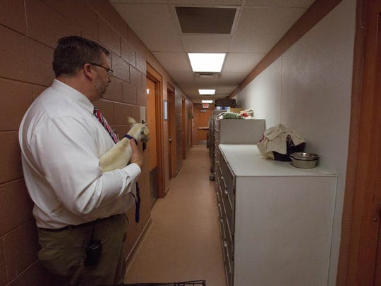 Clint Thacker, executive director of the the Animal Service Center of the Mesilla Valley, shows where animals are kept when recovering for surgery and explains the need for more space for animals in the shelter. The GO bonds that are being mailed out to voters will help fund projects like the building of a new animal shelter. Friday July 20, 2018.