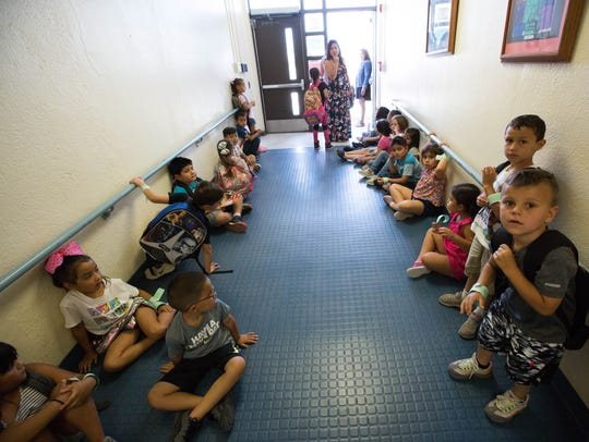 Students in the K-3 Plus program line the hall way