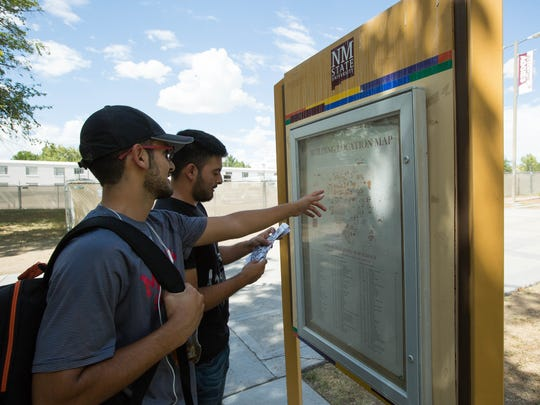 Allan Navarro, a sophomore kinesiology major, left, and his brother Chris Navarro, a junior secondary education major, both from Hobbs, search a map of the New Mexico State University campus for Gardiner Hall, Thursday Aug. 16, 2018. Early data from NMSU indicate first-time freshman enrollment is up approximately 10.7 percent from the same time last year.