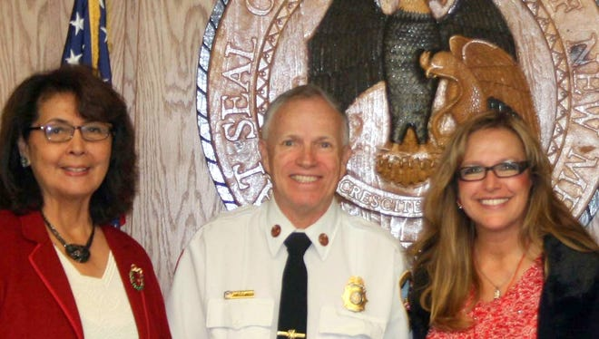 The New Mexico Public Regulation Commission bid a fond farewell to outgoing State Fire Marshal John Standefer, who is set to retire December 31, 2016, after serving New Mexico for 47 years in the fire service, 15 of those years as State Fire Marshal. From left are Commissioners Pat Lyons and Lynda Lovejoy, Fire Marshal Standefer, Commission Chair Valerie Espinoza, and Commissioners Sandy Jones and Karen Montoya.