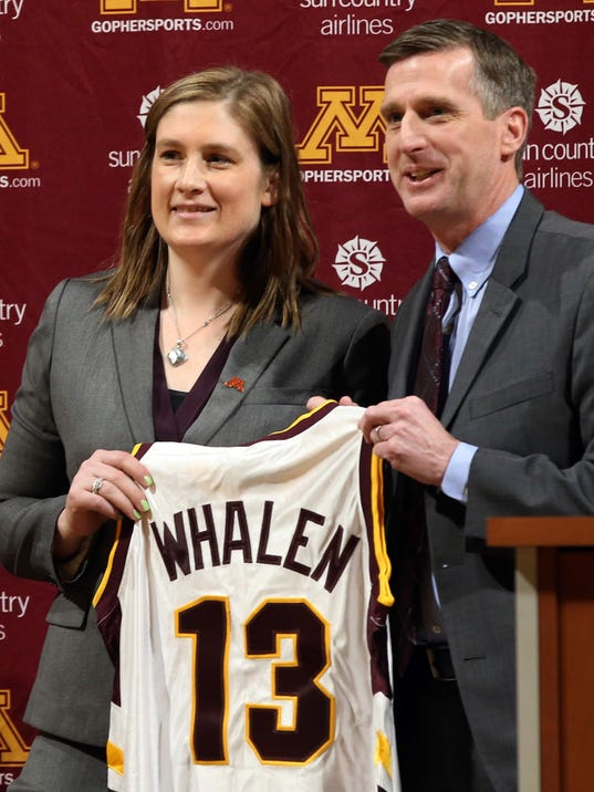University of Minnesota athletic director Coyle, right, and Lindsay Whalen hold up her playing jersey at Minnesota after she was introduced as Minnesota's new women's basketball coach Friday, April 13, 2018, in Minneapolis. (AP Photo/Jim Mone)