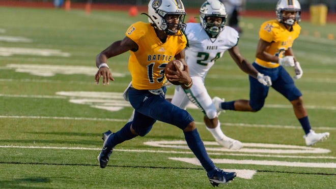 Battle quarterback Khaleel Dampier (13) runs to the outside before scoring a touchdown before halftime Friday.