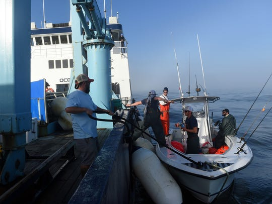 Crew members of the M/V OCEARCH prepare to set out