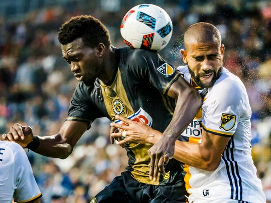 Philadelphia's C.J. Sapong (left) and LA's Leonardo (right) collide as they go up for a header in the first half of a 2-2 draw between the Philadelphia Union and the LA Galaxy at Talen Energy Stadium in Chester, Pa. on Wednesday night.