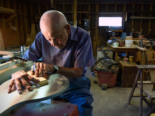 Ken Rudolph, 98, Annandale, works on the scroll saw in his wood shop, where he enjoys creating projects to give to others. He is shown Thursday, June 2, 2016, on the family farm near Annandale.