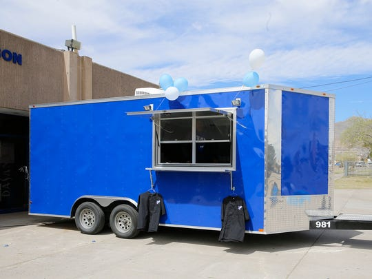 Members of the Bowie High School Culinary Arts Program served lunch Friday to EPISD officials and donors from local businesses and organizations that contributed money for the school's food truck, shown here. It will hit the streets at 8 a.m. Saturday at Henderson Middle School, 5505 Robert Alva Ave.