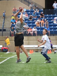 Minnesota Vikings wide receiver Adam Thielen intercepts