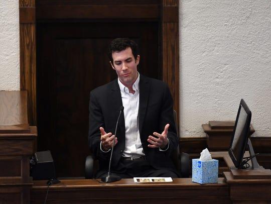 Childhood friend Jared Loftus speaks to the court in