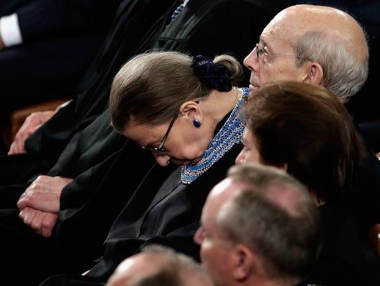 Supreme Court Justice Ruth Bader Ginsburg sits among