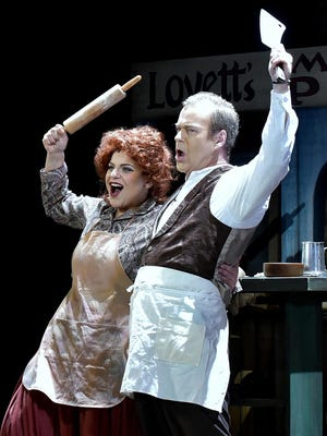 """Jenni Bank and Philip Cutlip star as Mrs. Lovett and Sweeney Todd in the Tri-Cities Opera production of """"Sweeney Todd."""""""