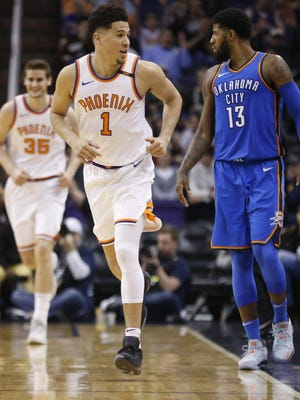 Suns Devin Booker (1) reacts running down court after hitting a three for his 4,000 point during the second half against the Thunder at Talking Stick Resort Arena on March 2, 2018 in Phoenix, Ariz.