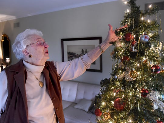Doris Hoffacker shows off the ornaments on the Christmas