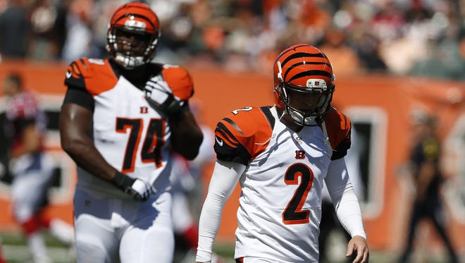 Bengals kicker Mike Nugent walks off after missing his third field goal attempt of the first quarter against the Atlanta Falcons at Paul Brown Stadium.