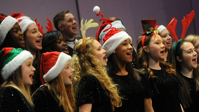 Is it legal to sing Christmas songs on public school concerts? Yes. In this 2013 file photo, the Synergy Vocal Ensemble performed during the York County Junior and Senior Honors Choirs concert at Central York High School.