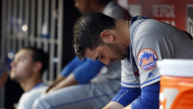 New York Mets starting pitcher Matt Harvey sits in the dugout during the fourth inning of Tuesday night's game against the Washington Nationals at Nationals Park in Washington.