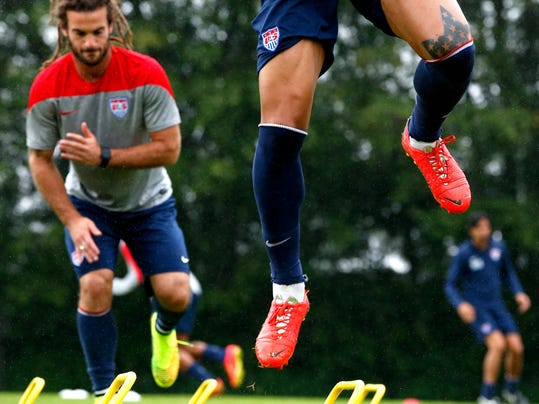 United States' Jermaine Jones, front, nd Kyle Beckerman work out during a training session at the Sao Paulo FC training center in Sao Paulo, Brazil, Tuesday, June 10, 2014. The U.S. will play in group G of the 2014 soccer World Cup. (AP Photo/Julio Cortez)