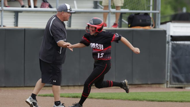 Aubrey Drohner rounds third after hitting a home run during their WIAA Division 1 quarterfinals game against Kenosha Tremper at Goodman Diamond last week. Drohner was named the Division 1 co-player of the year by the Wisconsin Fastpitch Softball Coaches Association this week.