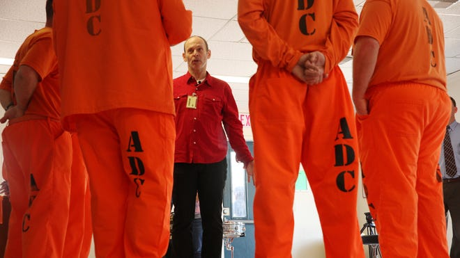 Wayne Kramer talks with inmates from Central Arizona Detention Center in Florence, Ariz.