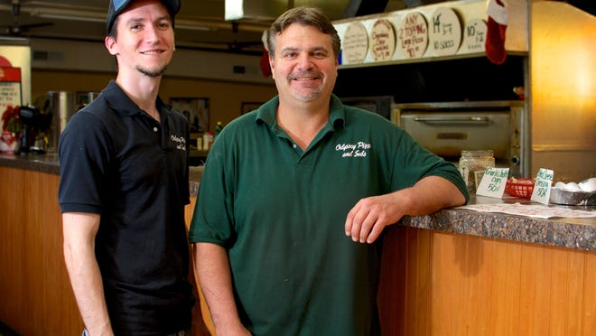 Rick McCabe, left, and Curtis Switzer are the new owners of Odyssey Pizza & Subs in Cocoa.