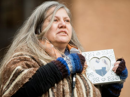 Rebecca Parr speaks about visiting her father in prison during a rally calling on the sheriff to immediately bring back in-person visits to the Knox County jail held outside the City-County Building in downtown Knoxville on Monday, January 29, 2018.