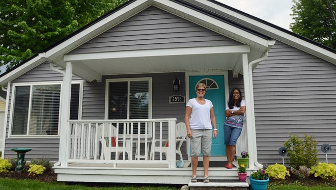 Joy Perdue, left, and Julia Guerra Sunday, June 5, at one of their properties they list on the rental website Airbnb.