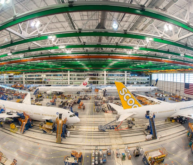 Boeing 787 aircraft in various stages of final assembly rest on the factory floor of Boeing's Charleston, S.C., facility on March 25, 2018.