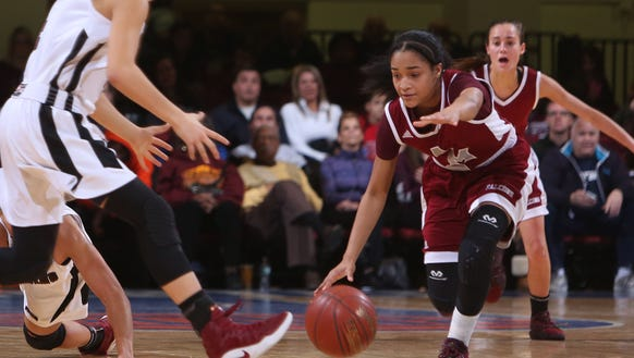 Ossining defeated Alberts Magnus 80-77 to win the Section