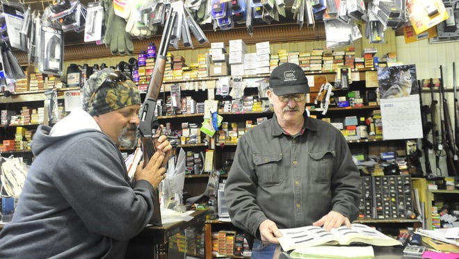 Brad Stuckman, right, owner of Bakers Sporting Goods in Bucyrus, helps Tim Shultz find a scope mount for his Henry 45.
