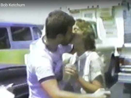 In this screen grab from a video produced by the late Bob Ketchum, Bob and Patty Lelly kiss after being pronounced man and wife on the Norfork Lake ferry on Aug. 8, 1980.