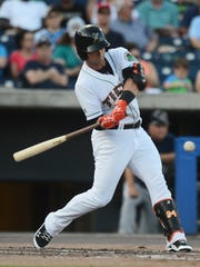 Norfolk Tides outfielder Christian Walker swings at