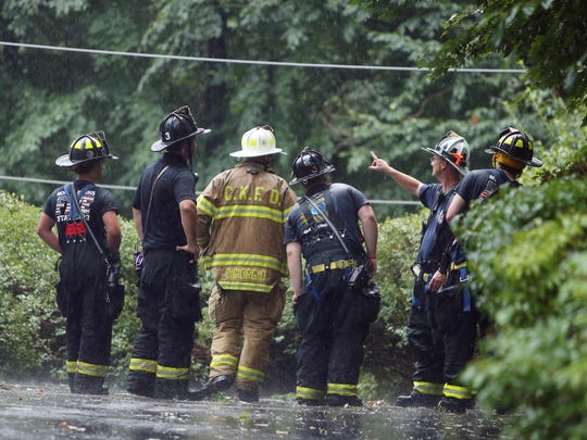 Firefighters inspect power lines in the aftermath of a powerful afternoon storm that took down power lines and trees leaving many without power. July 30, 2016, Morris Plains, NJ