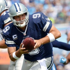 Dallas Cowboys quarterback Tony Romo (9) drops back into the pocket against the Tennessee Titans during the first half at LP Field in Nashville on September 14, 2014.