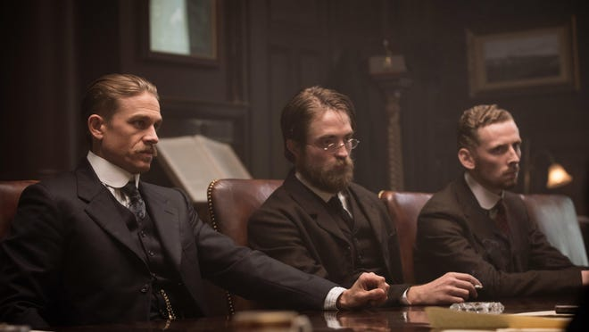 """Charlie Hunnam, from left, Robert Pattinson and Edward Ashley in a scene from """"The Lost City of Z."""""""