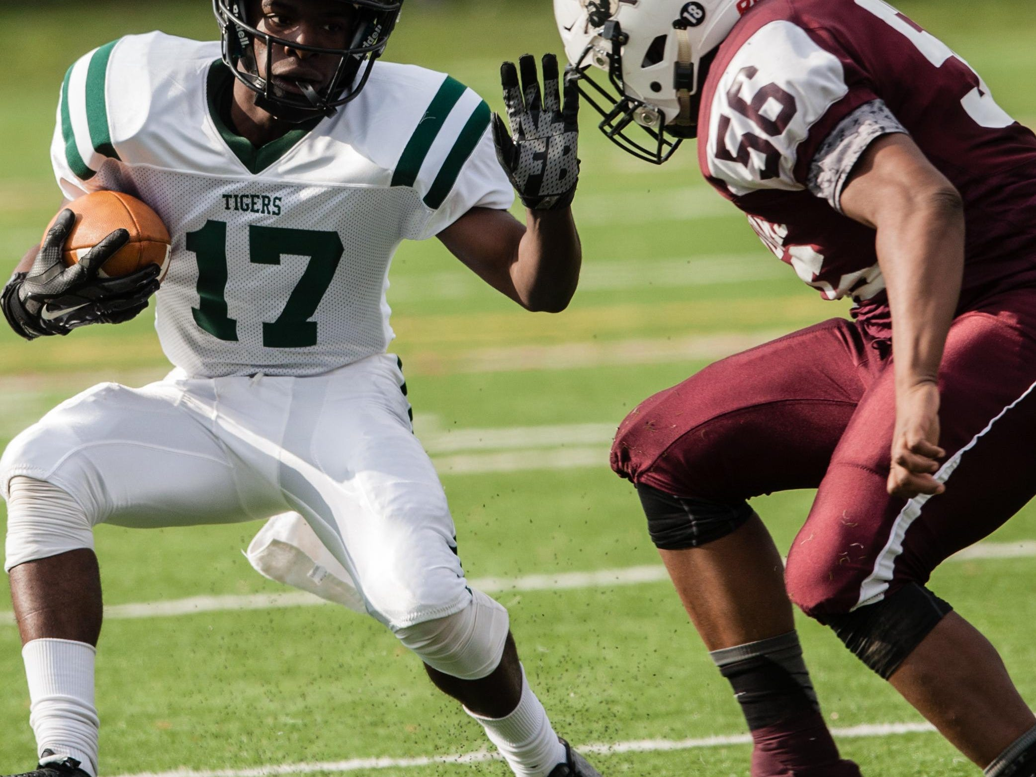 South Plainfield's Raeon Cohen (17) carries the ball as North Plainfield's Siraaj Price defends during Thursday's game.