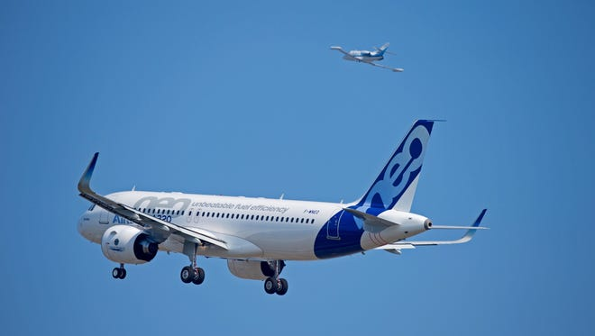 This image provided by Airbus shows the A320neo making its maiden flight on Sept. 25, 2014, over southern France.