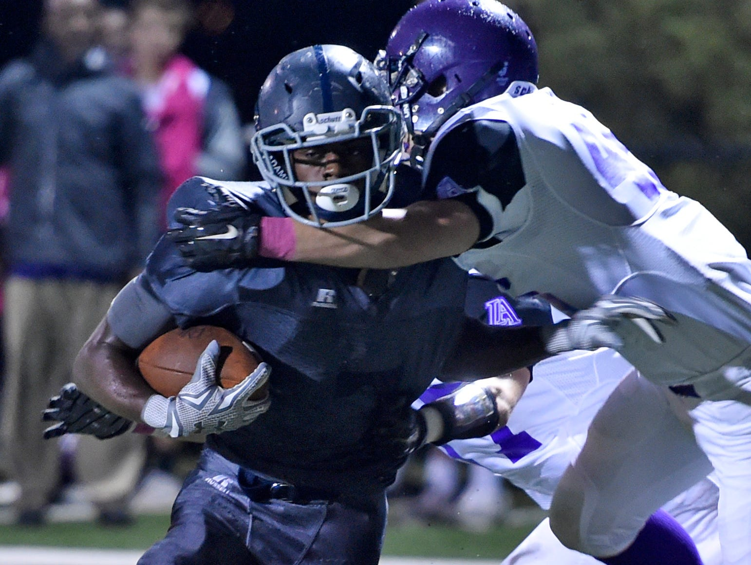 Franklin Road Academy running back Sam Harvin (3) powers past a Lipscomb defender during their game.