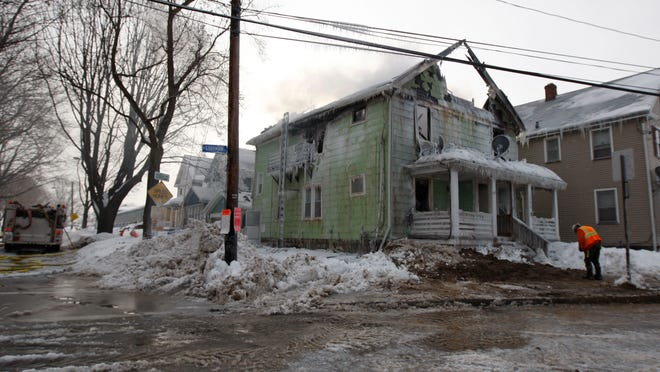 The two-family home, located on North Goodman Street near Clifford Avenue, will have to be torn down to completely extinguish the fire, said Rochester Deputy Chief George Peterson Jr.