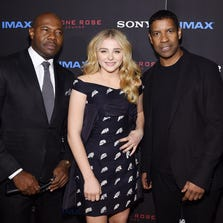 "NEW YORK, NY - SEPTEMBER 22:  (L-R) Filmmaker Antoine Fuqua, actress Chloe Grace Moretz, and actor Denzel Washington attend the ""The Equalizer"" New York premiere at AMC Lincoln Square Theater on September 22, 2014 in New York City.  (Photo by Jamie McCarthy/Getty Images)"
