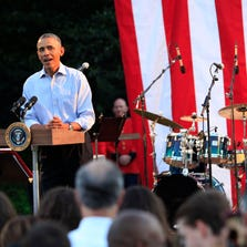 President Obama speaks to lawmakers at the White House picnic.