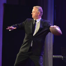 """NEW YORK, NY - MAY 15:  Color commentator Boomer Esiason performs at the 2014 Toys """"R"""" Us Children's Fund Gala at the New York Marriott Marquis on May 15, 2014 in New York City.  (Photo by Andrew H. Walker/Getty Images for Toys R Us)"""