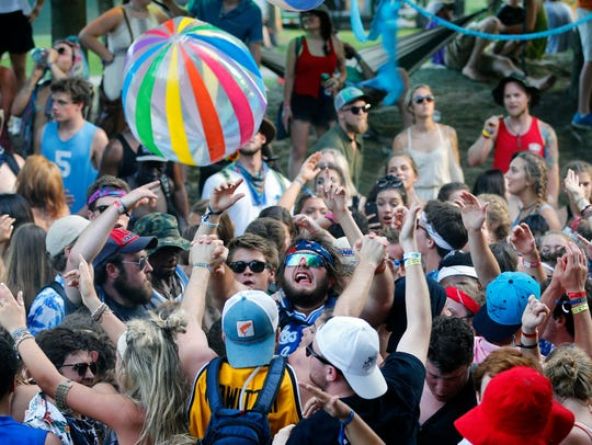 Party Cove crowds dance to a DJ at Forecastle. July
