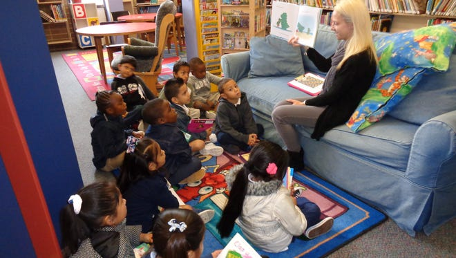 Sasha Earl, a kindergarten teacher at Bridgeton Public Charter School, reads a story to her students during a visit to Cumberland County Library.