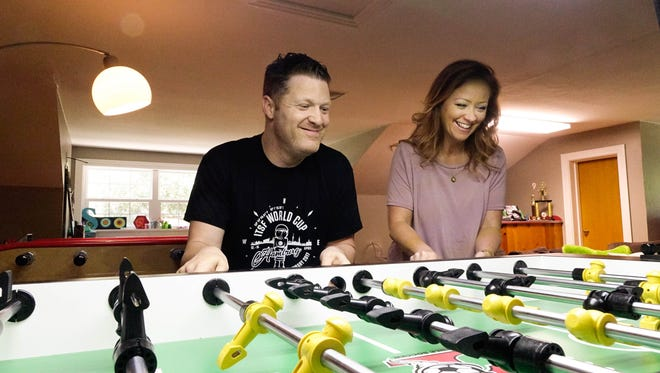 Terry Rue and his wife Keisha play foosball at home in Crowley Thurs., June 8, 2017.