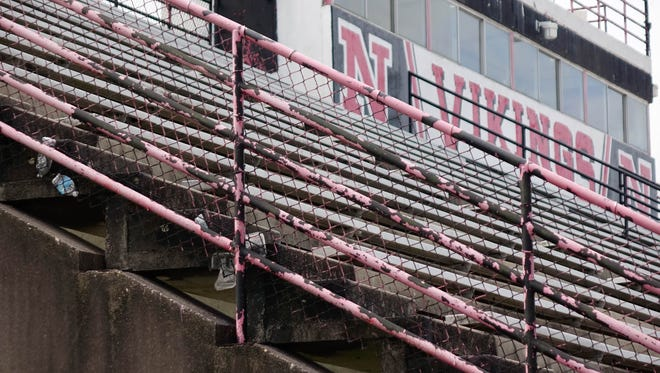 Paint peeling on the railing of the grandstands at Northside High's football stadium in Lafayette. Weds., June 14, 2017.