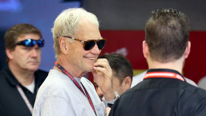 Team co-owner David Letterman chats Sunday in his garage area.