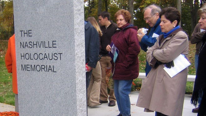 Visitors look at a Holocaust memorial at the Gordon Jewish Community Centerin this file photo.
