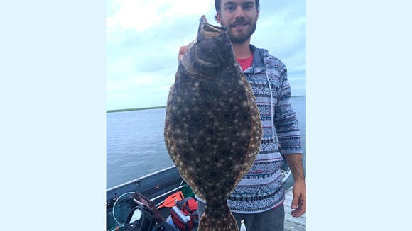 Phil Cress with a 4 ppound keeper flounder caught in the back bays of Brigantine.