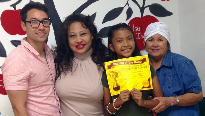 """Cecelia Rose Ysabella Borja received the Student of the Month award at Upi Elementary School. She is a straight-A student and in the Gifted and Talented Education programl. Pictured from left: Justin Michael (Brother), Rose Mafnas (Mom), """"Cece"""" Borja and Chai Cundiff (Grandmother)."""