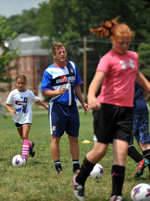 Steve Slade, 23, from Torquay, England, leads the British Soccer Camp on Thursday at the East Main Street Soccer Complex in Lancaster.