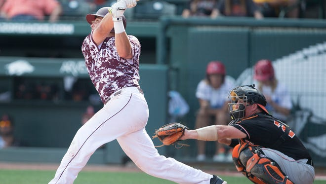 Missouri State shortstop Jeremy Eiermann hits a walk-off home run in the bottom of the ninth inning during the Bears game vs. Oklahoma State University in the NCAA Regional at Baum Stadium in Fayetteville, Ark. on Friday, June 2, 2017.
